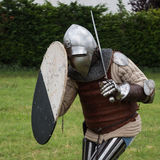 Knight in Battle with Silver Helmet, Armor, Shield and Sword Stock Photography