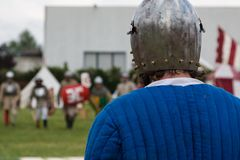 Knight in Battle with Silver Helmets and Shield. Medieval Event Reconstruction Stock Photography