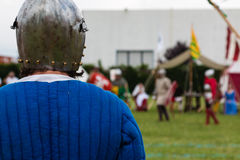 Knight in Battle with Silver Helmets and Shield. Medieval Event Reconstruction Stock Image