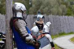 Knight before battle. Knight standing before festival battle Royalty Free Stock Photo