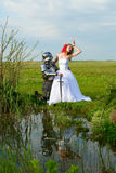 The knight and bride. On a background of lake Royalty Free Stock Photos