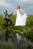 The knight and bride. On a background of lake Stock Image