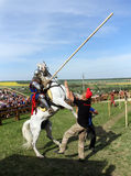 Knight on bucking horse. KHOTYN - MAY 10: Knight with lance riding a bucking horse during Festival Medieval Khotyn on May 10, 2013, Ukraine Royalty Free Stock Image