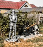 Knight and cannon. Decorative knight and a cannon near the house Royalty Free Stock Photo