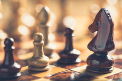Knight Chess. Closeup knight of chess game on wood board Royalty Free Stock Photo