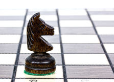 Knight on a chessboard Royalty Free Stock Image