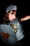 Knight. Child playing with a medieval knight costume Stock Image