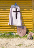 Knight cloak on wooden wall Stock Photo