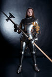 Knight on dark background Stock Photos