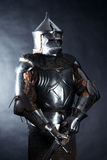 Knight on dark background royalty free stock photography