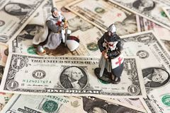 Knight and dollars royalty free stock image