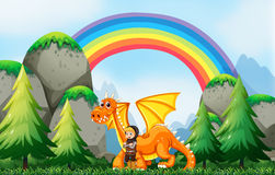 Knight and dragon. In the field with rainbow background Stock Photo