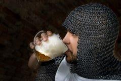 Knight drinking bear Stock Image