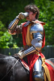 Knight Drinking at Renaissance Festival Stock Photography