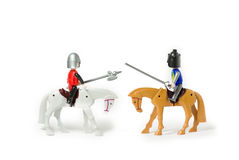 Knight duel. Toy knights isolated on white Royalty Free Stock Photos