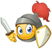 Knight emoticon. Holding a sword and shield Stock Photo