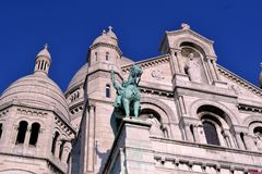 Knight and facade of Paris Sacre Coeur Basilica. Stock Photo