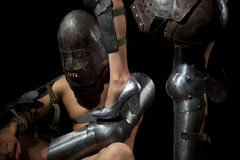 Knight with female leg Royalty Free Stock Photo