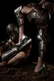 Knight with female leg. A knight in armour worshiping and holding female leg Royalty Free Stock Image