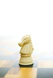 Knight figure on chessboard. Picture of a Knight figure on chessboard Royalty Free Stock Photography