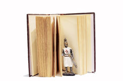 Knight figure coming from old open book. Knight figure coming from fairy tale or history book Royalty Free Stock Image