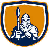 Knight Full Armor Holding Paint Brush Crest Retro. Illustration of knight in full armor holding paint brush viewed from front set inside shield crest on isolated Stock Photo