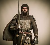 Knight in full armour. Medieval knight with sword and shield Royalty Free Stock Image
