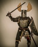 Knight in full armour. Medieval knight with sword and shield Stock Image