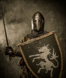 Knight in full armour Stock Photo