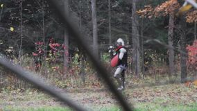 Knight guards a camp in the forest medieval protection  historical. Watch stock footage