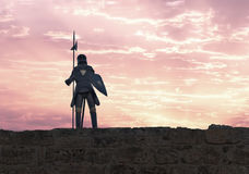 Knight with halberd. A knight with halberd in black armour Stock Image