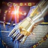 Knight hand. Hand of a knight holding shiny sword Royalty Free Stock Photography