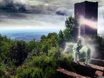Knight haunting. A  knights ghost haunting the surroundings of his castle in ruins, on the top of the mountain Stock Photo