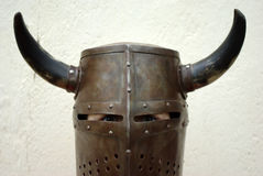 Knight helmet. Closeup shot of a boy dressed up on a medieval knight helmet with horns Stock Photo