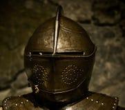 Knight helmet. A medieval knight helmet of shining metal Royalty Free Stock Image