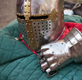 Knight helmet and glove. A metal knight's helmet and glove Stock Image