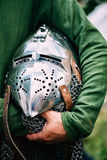 Knight Helmet Of Medieval Suit Of Armour On Table Stock Photo