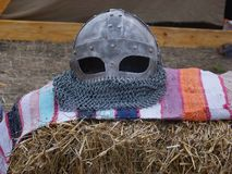 Knight helmet. On Romanian hand woven carpet Royalty Free Stock Photography