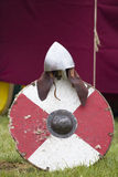 Knight helmet and round shield Royalty Free Stock Images