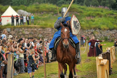 Knight helmet and shield on horseback through the joust Stock Image