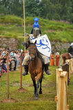 Knight helmet and shield on horseback through the joust Royalty Free Stock Images