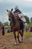Knight helmet and shield on horseback through the joust Royalty Free Stock Image