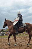 Knight helmet and shield on horseback through the joust Stock Photography