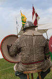 Knight with Helmet and Shield seated on a Chair. Medieval Event Reconstruction Stock Images