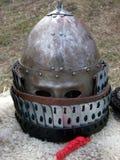 Knight helmet. Sitting on sheepskin Stock Photography
