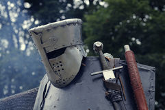 Knight helmet with sword Stock Images