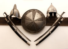 Knight helmets swords shield. Knight helmets, swords and shields kept as exhibits in the Niasvizh palace museum in Belarus Stock Image