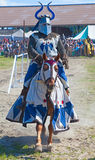 Knight. HINWIL, SWITZERLAND - MAY 18: Unidentified men in knight armor on the horse ready for action during tournament reconstruction near Kyburg castle on May Stock Photos
