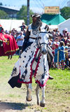 Knight. HINWIL, SWITZERLAND - MAY 18: Unidentified men in knight armor on the horse ready for action during tournament reconstruction near Kyburg castle on May Stock Photo