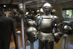 The knight with his helmets and armor Stock Images